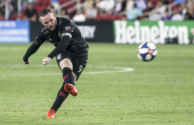 Wayne Rooney scored an incredible goal from beyond midfield on Wednesday night, leading D.C. United past Orlando City. (Tony Quinn/Getty Images)