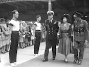 The Royal Couple inspect the PT Guard of Honour at the Royal Tournament at Olympia. The tournament was a major military tattoo and pageant and was first held in 1880, and was axed in 1999 as part of a cost-cutting exercise.