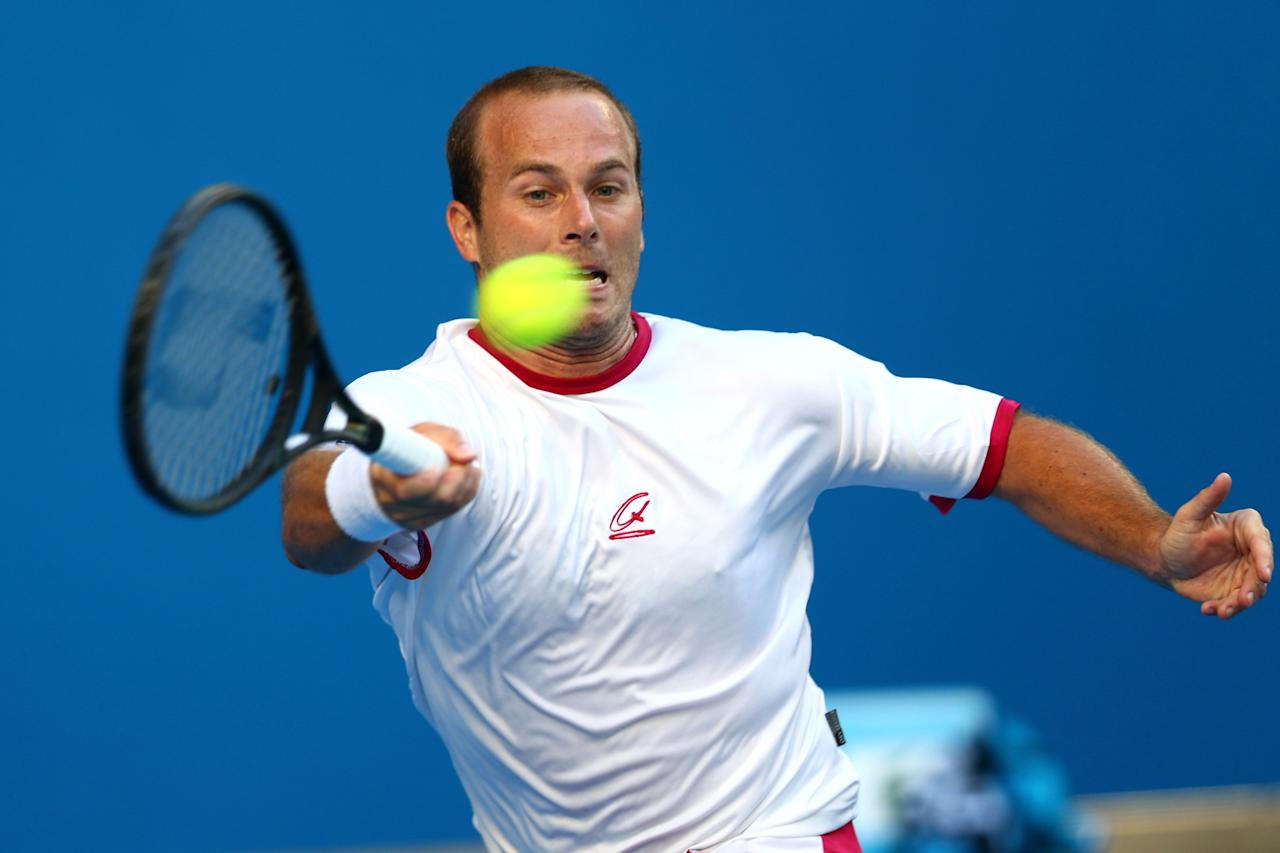 MELBOURNE, AUSTRALIA - JANUARY 14:  Olivier Rochus of Belgium plays a forehand in his first round match against David Ferrer of Spain during day one of the 2013 Australian Open at Melbourne Park on January 14, 2013 in Melbourne, Australia.  (Photo by Mark Kolbe/Getty Images)