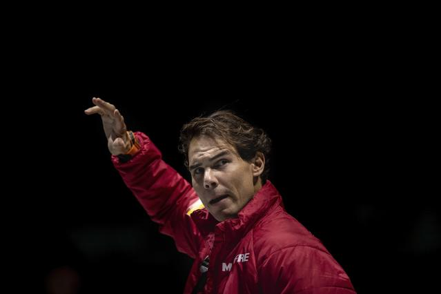 Spain's Davis Cup player Rafael Nadal salutes to supporters in Madrid, Spain, Sunday, Nov. 17, 2019. The 18 teams will play in six groups of three, with the group winners advancing to the knockout stage along with the two best second-place teams. The nations will play within their groups Monday-Thursday, with the knockout rounds Friday-Sunday. The matches will take place on hard courts in three stadiums in morning and afternoon sessions that will include two singles matches and a doubles match. (AP Photo/Bernat Armangue)