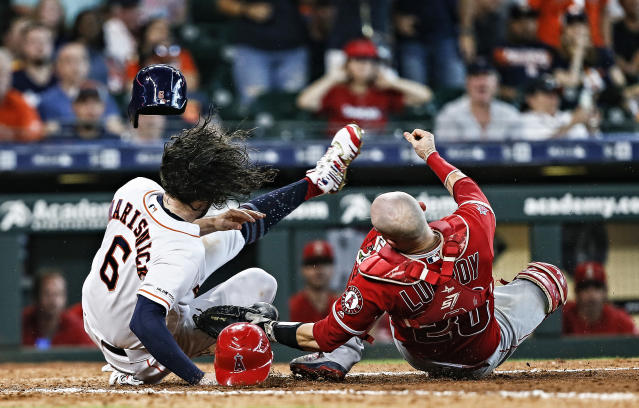 Jake Marisnick collides with catcher Jonathan Lucroy as he attempts to score in the eighth inning at Minute Maid Park on July 07, 2019 in Houston, Texas. Marisnick was called out under the home plate collision rule. (Getty Images)