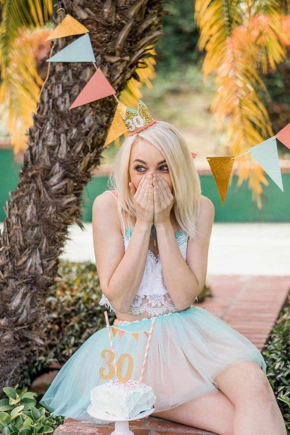 """<p>In our opinion, you're <em>never </em>too old to wear a birthday crown (or, do anything, really). Whether it's for your own birthday or your toddler's virtual party, we say the more sparkle, the better.</p><p><a class=""""link rapid-noclick-resp"""" href=""""https://go.redirectingat.com?id=74968X1596630&url=https%3A%2F%2Fwww.etsy.com%2Flisting%2F552888564%2F30th-birthday-for-her-adult-30-birthday&sref=https%3A%2F%2Fwww.oprahmag.com%2Flife%2Fg32466287%2Fvirtual-birthday-party-ideas%2F"""" rel=""""nofollow noopener"""" target=""""_blank"""" data-ylk=""""slk:SHOP BIRTHDAY CROWNS"""">SHOP BIRTHDAY CROWNS</a></p>"""