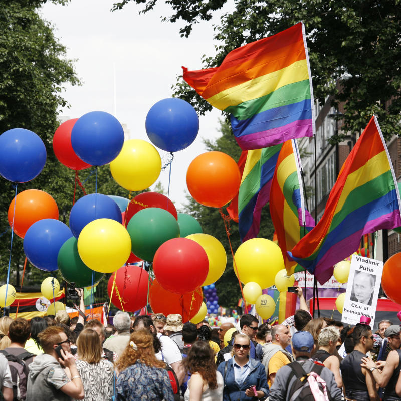 London, UK - June 29, 2013: Rainbow flag and baloons in London's Gay Pride, people present, estimated 25,000 people took part in the march, Parade to support gay rights.