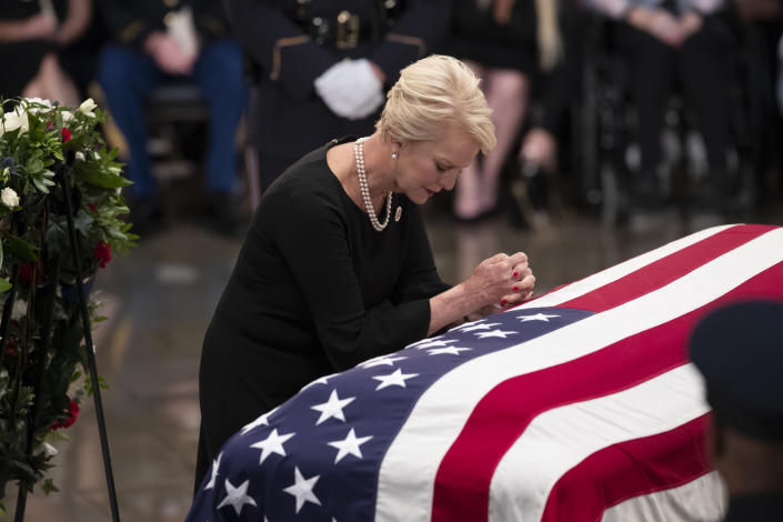 Cindy McCain, wife of Sen. John McCain, R-Ariz., leans on his flag-draped casket during a farewell ceremony in the U.S. Capitol rotunda, Friday, Aug. 31, 2018, in Washington. McCain was a six-term senator, a former Republican nominee for president, and a Navy pilot who served in Vietnam, where he endured five-and-a-half years as a prisoner of war. He died Aug. 25 from brain cancer at age 81. (AP Photo/J. Scott Applewhite)