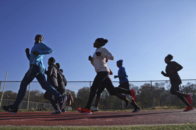 A group of Ethiopian runners works out at Van Cortlandt Park in the Bronx borough of New York, Tuesday, Nov. 26, 2019. Girma Bekele Gebre stunned the elite field at the New York City Marathon by finishing third as a nonelite entrant in November. It was a life-changing performance for the Ethiopian runner, and one made possible because of his involvement with the West Side Runners' Club. Team President Bill Staab has spent four decades helping immigrant runners acquire visas and gain entry to U.S. races, spending nearly $1 million of his own money to cover fees. Bekele Gebre is his greatest success, but not nearly the only runner he's helped. (AP Photo/Seth Wenig)