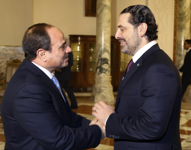 In this photo released by Lebanon's official government photographer Dalati Nohra, Lebanese Prime Minister Saad Hariri who resigned in a televised message on Nov. 4 from Saudi Arabia, right, shakes hands with Egyptian President Abdel-Fattah el-Sissi, left, in Cairo, Egypt, on Tuesday, Nov. 21, 2017. Hariri arrived in Egypt on Tuesday and went straight into talks with the Egyptian president who, together with France's leader, is reportedly trying to mediate a way out of the crisis in Lebanon that would involve rolling back Hariri's resignation. (Dalati Nohra via AP)