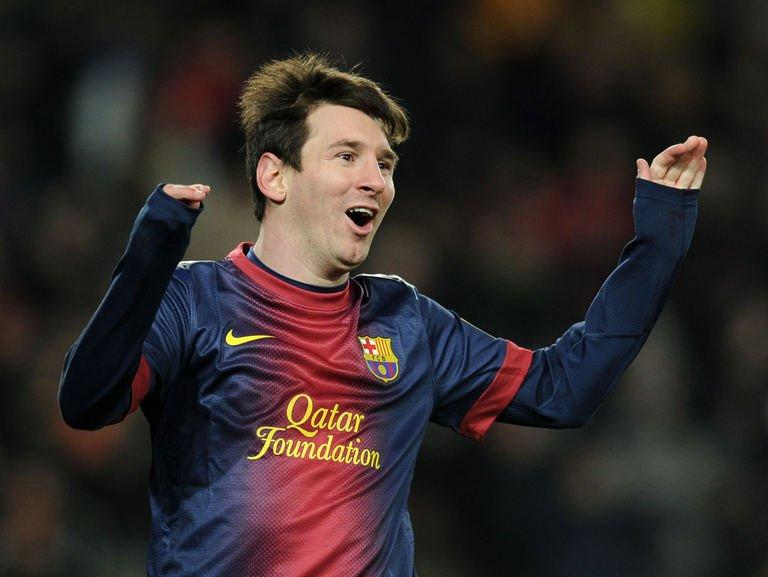 Barcelona's forward Lionel Messi celebrates after scoring during their Spanish league football match against Sevila at the Camp Nou stadium in Barcelona on February 23, 2013. Barcelona stretched their advantage at the top of La Liga to 15 points as two goals in eight minutes just before the hour mark from David Villa and Lionel Messi handed them a 2-1 win over Sevilla