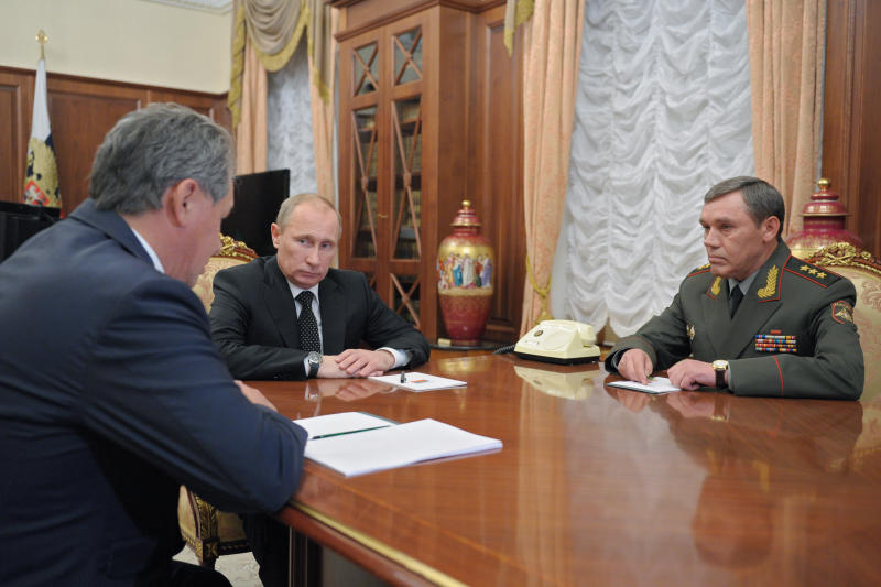 From left: Defense Minister Sergei Shoigu, President Vladimir Putin and Col. Gen Valery Gerasimov meet in Moscow's Kremlin on Friday, Nov. 9, 2012. On Friday, Putin named Col. Gen. Valery Gerasimov the new chief of the armed forces' General Staff to replace Gen. Nikolai Makarov. He also reshuffled several other top generals. (AP Photo/RIA Novosti, Alexei Druzhinin, Presidential Press Service)