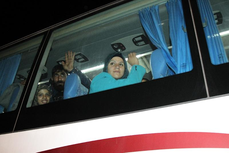 A bus, part of a convoy carrying Shiite residents from the Syrian towns of Fuua and Kefraya, drives out of Beirut International airport on December 29, 2015 as part of a UN-backed truce relocating evacuees to Damascus (AFP Photo/Anwar Amro)