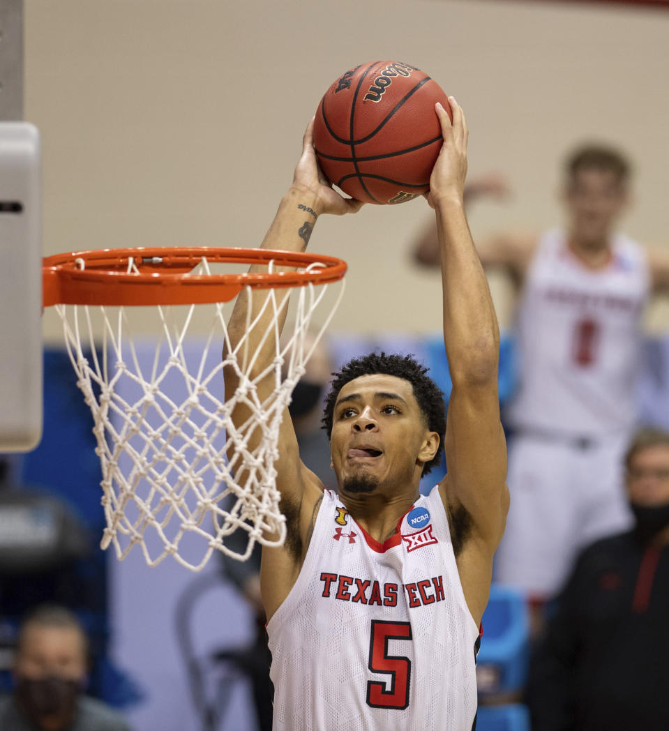 Texas Tech guard Micah Peavy (5) scores with a slam dunk during the second half of a first round game against Utah State in the NCAA men's college basketball tournament, Friday, March 19, 2021, at Assembly Hall in Bloomington, Ind. (AP Photo/Doug McSchooler)