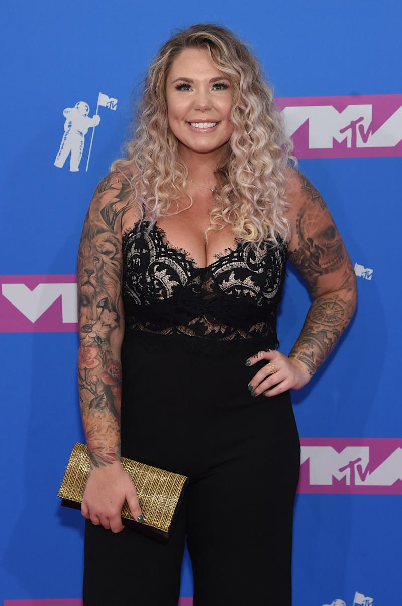 Kailyn Lowry sports an amazing black jumpsuit that leaves nothing to imagination in her cleavage area