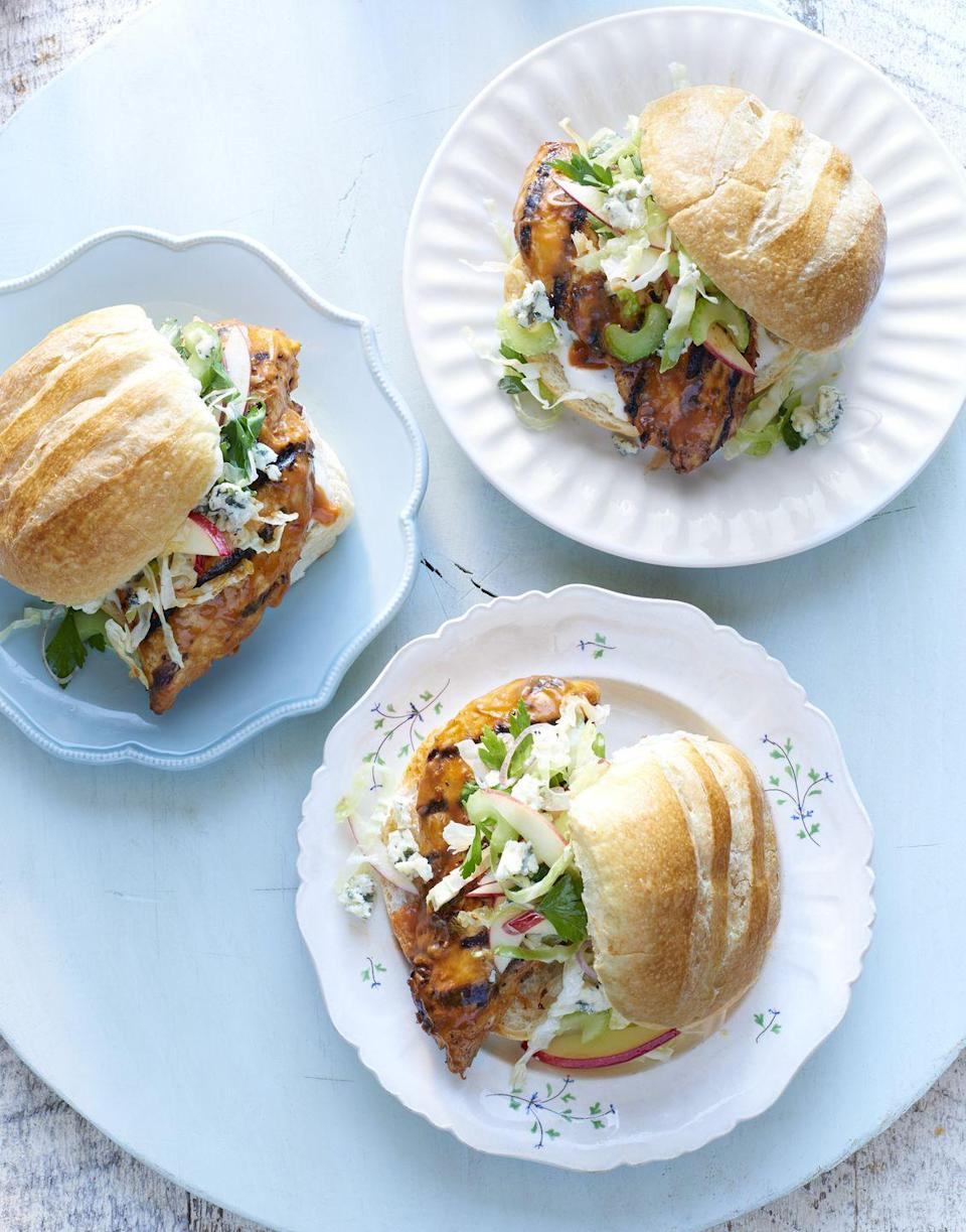 """<p>Save some napkins and serve this party-friendly sammy in place of sticky wings. (And the accompanying Blue Cheese-Apple Slaw will put a standard dipping sauce to shame.)</p><p><a href=""""https://www.goodhousekeeping.com/food-recipes/a14818/grilled-buffalo-chicken-sandwiches-recipe-clx0315/"""" rel=""""nofollow noopener"""" target=""""_blank"""" data-ylk=""""slk:Get the recipe for Grilled Buffalo Chicken Sandwiches »"""" class=""""link rapid-noclick-resp""""><em>Get the recipe for Grilled Buffalo Chicken Sandwiches »</em></a></p>"""