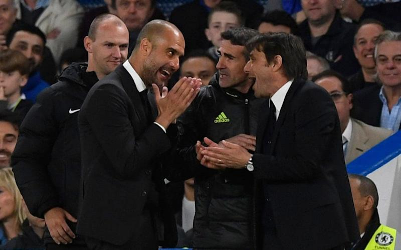 Passions running high: Chelsea's manager Antonio Conte and Manchester City's manager Pep Guardiola argue - EPA
