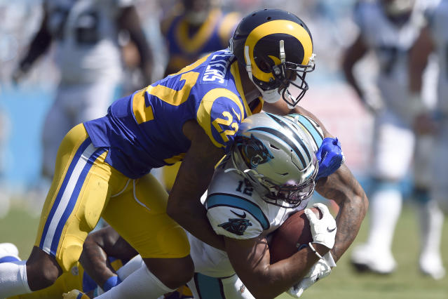Los Angeles Rams cornerback Marcus Peters (22) tackles Carolina Panthers wide receiver D.J. Moore (12) during the second half of an NFL football game in Charlotte, N.C., Sunday, Sept. 8, 2019. (AP Photo/Mike McCarn)