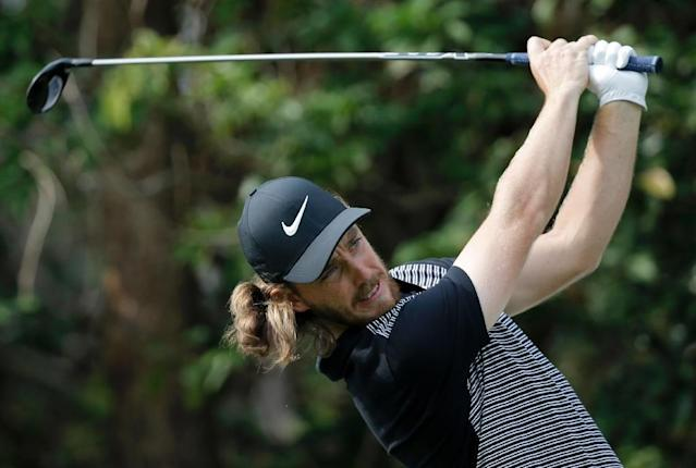 Three in a row? Tommy Fleetwood will bid to kick off the year with another Abu Dhabi title (AFP Photo/Vivek PRAKASH)