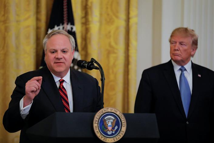 U.S. President Donald Trump listens to U.S. Interior Secretary David Bernhardt speak during an event at the White House in July. (Photo: Carlos Barria / Reuters)