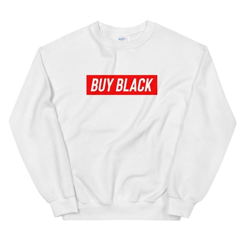 "Get the <a href=""https://shop.obws.com/collections/buy-black/products/buy-black-sweatshirt"" target=""_blank"" rel=""noopener noreferrer"">""Buy Black"" sweatshirt from Official Black Wall Street for $40</a>"