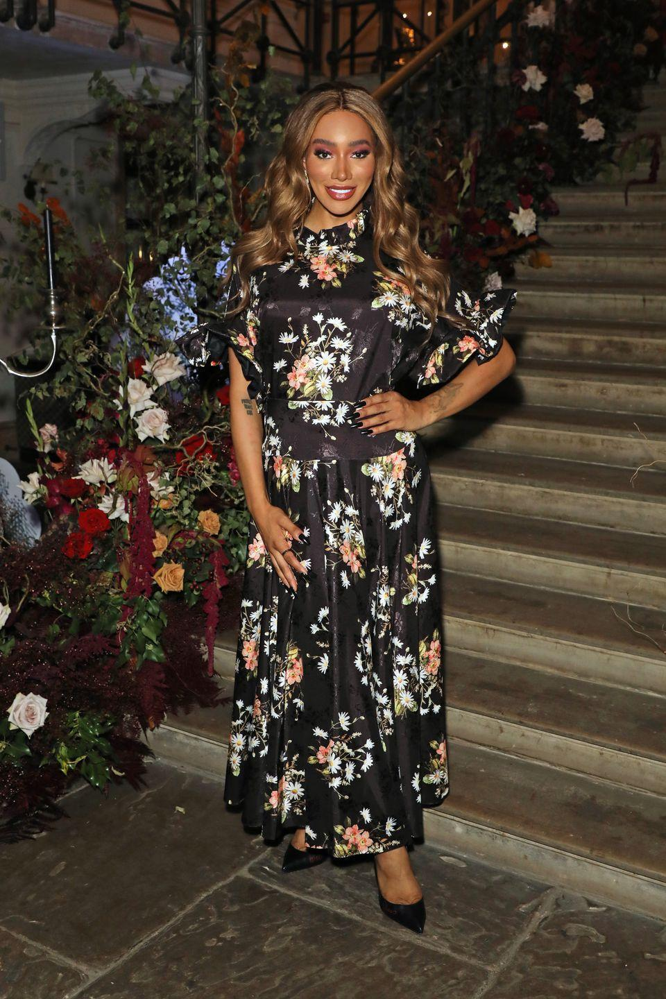 <p><strong>22 September</strong></p><p>The model paired her floral dress with classic black courts and Harris Reed x Missoma jewellery. </p>
