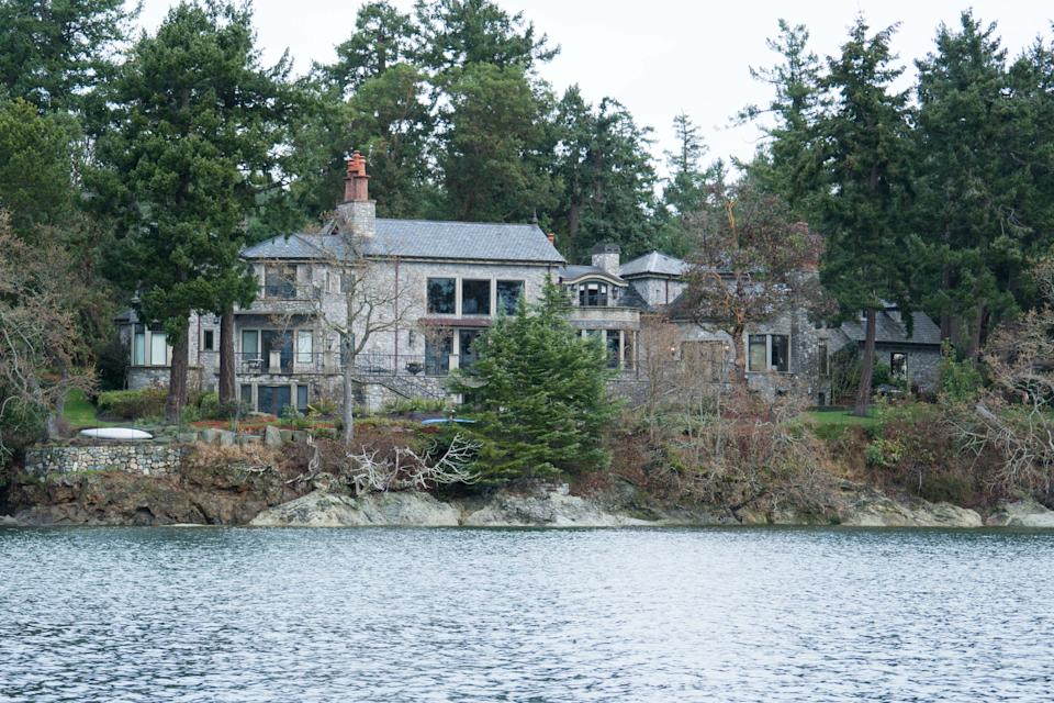 The residence of Prince Harry and and his wife Meghan is seen in Deep Cove Neighborhood  from a boat on the Saanich Inlet, North Saanich, British Columbia on January 21, 2020. - The new neighbors have been spotted out hiking and down at the farmers' market, but residents of North Saanich say they will ensure privacy for Harry and Meghan at their Canadian island hideaway. The Duke and Duchess of Sussex, along with their baby son Archie, are living at the scenic, wooded property of Mille Fleurs on Vancouver Island after exiting from their royal roles. (Photo by Mark GOODNOW / AFP) (Photo by MARK GOODNOW/AFP via Getty Images)