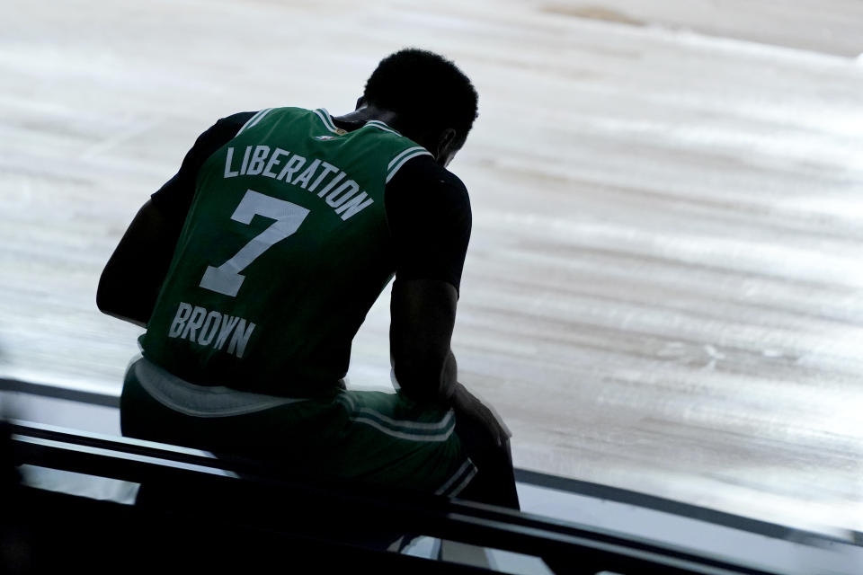 Jaylen Brown sits on the bench.