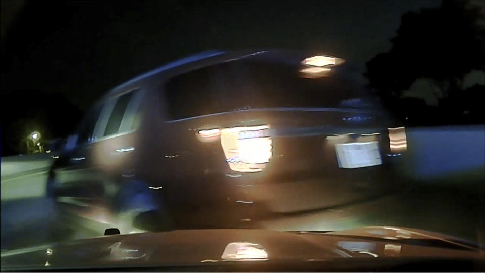 This screen shot taken from dash cam video owned by the Arkansas State Police shows the moment before a woman's car flipped over as an Arkansas State Police trooper Rodney Dunn attempted to pull her over in Pulaski County, Ark. in July 2020. An Arkansas woman is suing the state police after she says a trooper crashed into her car, causing it to flip, after she didn't immediately pull over for a traffic stop. An attorney for Janice Nicole Harper filed the lawsuit last month, May 2021, in Pulaski County against trooper Rodney Dunn and the Arkansas State Police. (Arkansas State Police via AP).