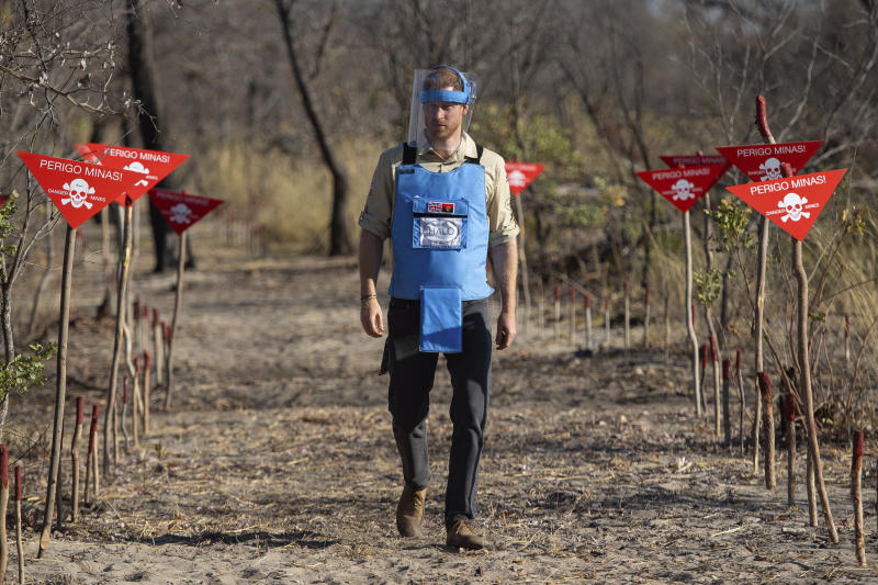 FILE - In this  Friday, Sept. 27, 2019 file photo, Britain's Prince Harry walks through a minefield in Dirico, Angola, during a visit to see the work of landmine clearance charity the Halo Trust, on day five of the royal tour of Africa. The final day of Prince Harry and his wife Meghan's 10-day visit to Africa with infant son Archie in tow has been overshadowed by a lawsuit she has filed against Britain's Mail on Sunday tabloid.  (Dominic Lipinski/Pool via AP, File)