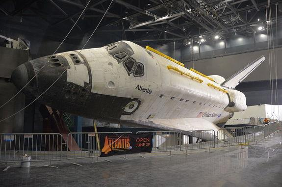 Space shuttle Atlantis is seen fully-exposed, its protective shrink-wrap cover removed, at NASA's Kennedy Space Center Visitor Complex in Florida, April 26, 2013.