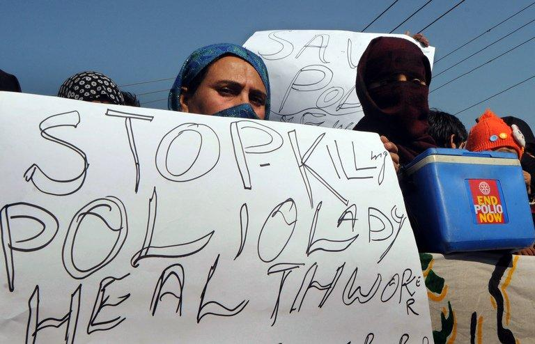 Pakistani polio vaccination workers carry placards during a protest against the killing of their colleagues in Lahore on December 21, 2012. Pakistan is providing paramilitary and police support to polio vaccinations being resumed discreetly in the northwest after a series of attacks on medical workers, officials said Friday