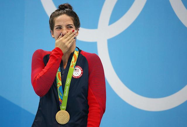 <p>Maya DiRado of USA poses with her gold medal for the women's 200m backstroke at the Aquatics Stadium in Rio on August 12, 2016. (REUTERS/Michael Dalder) </p>