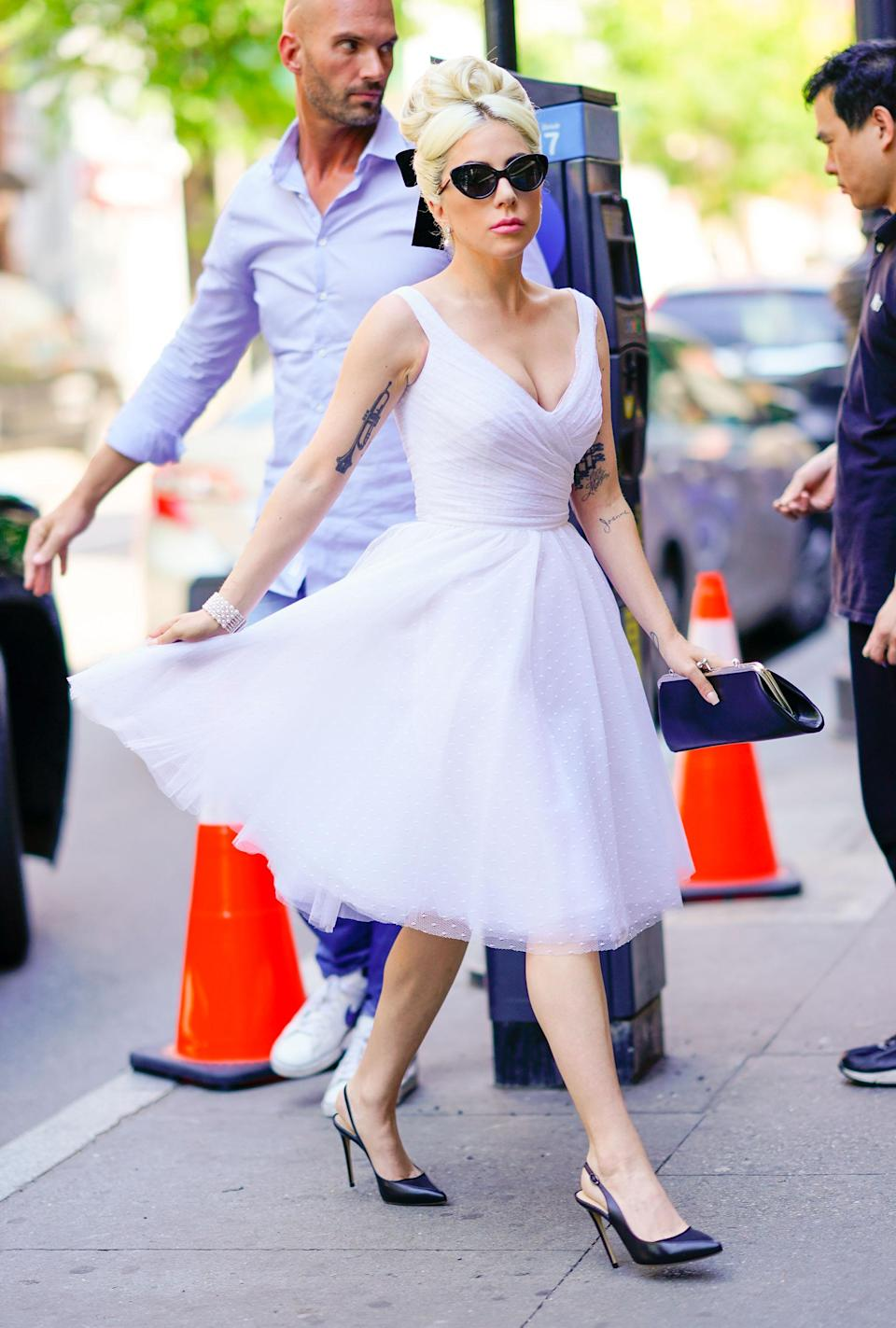 <p><span>Never a dull moment with Lady Gaga, who rocked a tulle, white ballerina dress for running errands in New York. <em>[Photo: Getty]</em></span> </p>