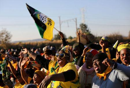 FILE PHOTO: African National Congress suppoters chant slogans during ANC president Jacob Zuma's election campaign in Atteridgeville a township located to the west of Pretoria, South Africa