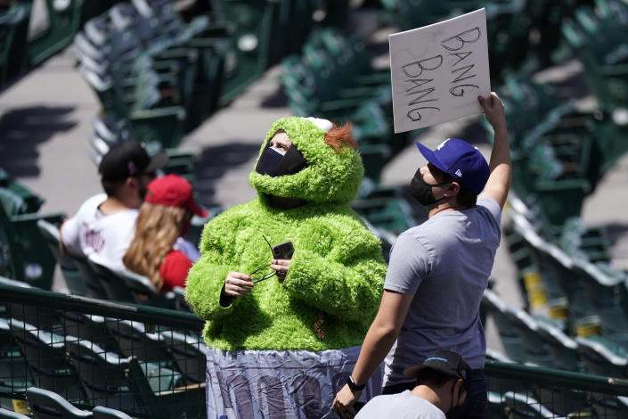 ADDS FULL NAME OF COSTUME - A fan wears an Oscar the Grouch costume as he taunts the Houston Astros prior to a baseball game against the Los Angeles Angels Tuesday, April 6, 2021, in Anaheim, Calif. (AP Photo/Mark J. Terrill)