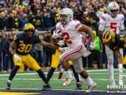 Dobbins has career day as Buckeyes rout Michigan