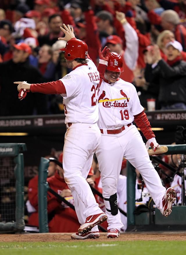 ST LOUIS, MO - OCTOBER 20: David Freese #23 and Jon Jay #19 of the St. Louis Cardinals celebrate after Freese scores on an RBI single by Allen Craig #21 in the seventh inning during Game Two of the MLB World Series against the Texas Rangers at Busch Stadium on October 20, 2011 in St Louis, Missouri. (Photo by Jamie Squire/Getty Images)