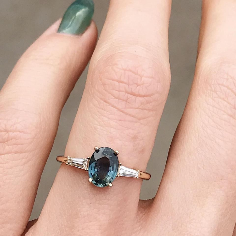 "$6000, Marrow Fine. <a href=""https://www.marrowfine.com/collections/alternative-engagement-rings/products/teal-oval-tapered-baguettes-engagement-ring"" rel=""nofollow noopener"" target=""_blank"" data-ylk=""slk:Get it now!"" class=""link rapid-noclick-resp"">Get it now!</a>"