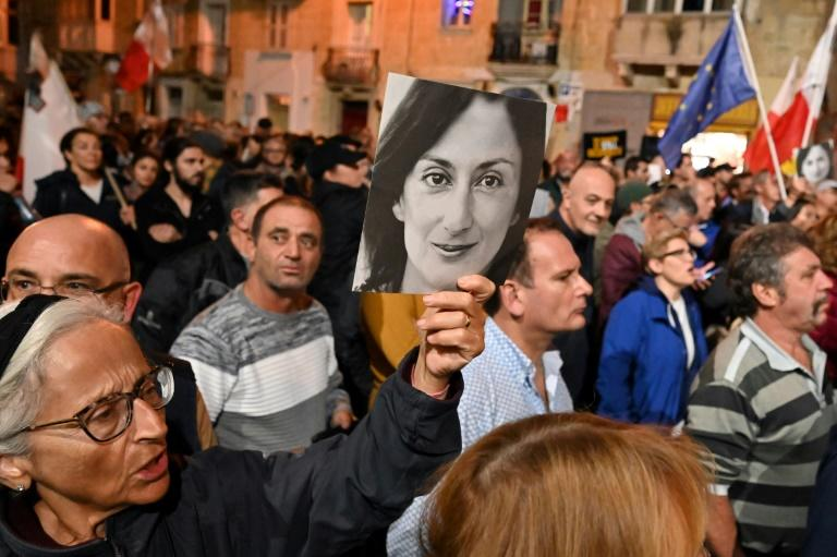 Demonstrators have called for the resignation of Muscat over the 2017 killing of journalist Daphne Caruana Galizia (AFP Photo/ANDREAS SOLARO)