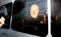 WikiLeaks founder Julian Assange is seen in a police van, after he was arrested by British police, in London, Britain April 11, 2019. REUTERS/Henry Nicholls