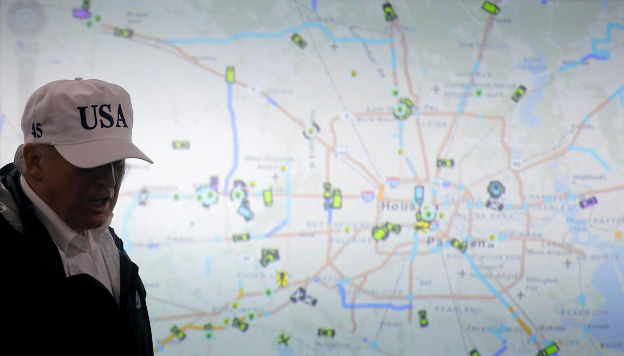<p>President Donald Trump walks in front of a map of Houston during a briefing on Tropical Storm Harvey relief efforts at the Texas Department of Public Safety Emergency Operations Center in Austin, Texas, Aug. 29, 2017. (Photo: Carlos Barria/Reuters) </p>