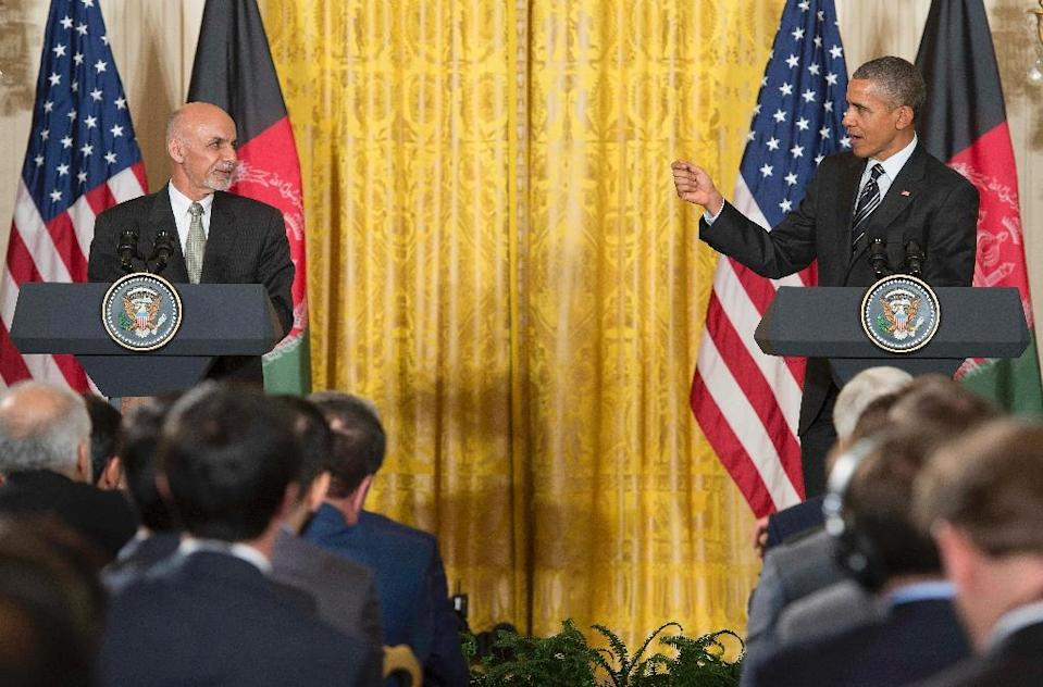 US President Barack Obama (R) with Afghanistan President Ashraf Ghani during a joint press conference at the White House in Washington, DC, March 24, 2015 (AFP Photo/Jim Watson)