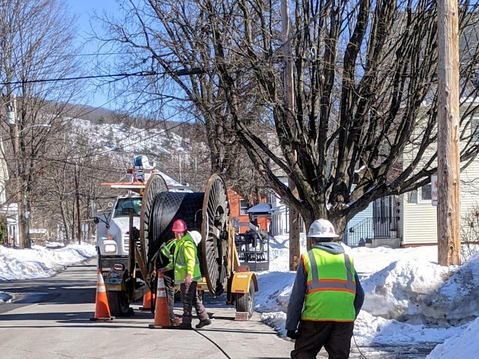 Workers hanging fiber optic cables in Brattleboro. Alex Lockie