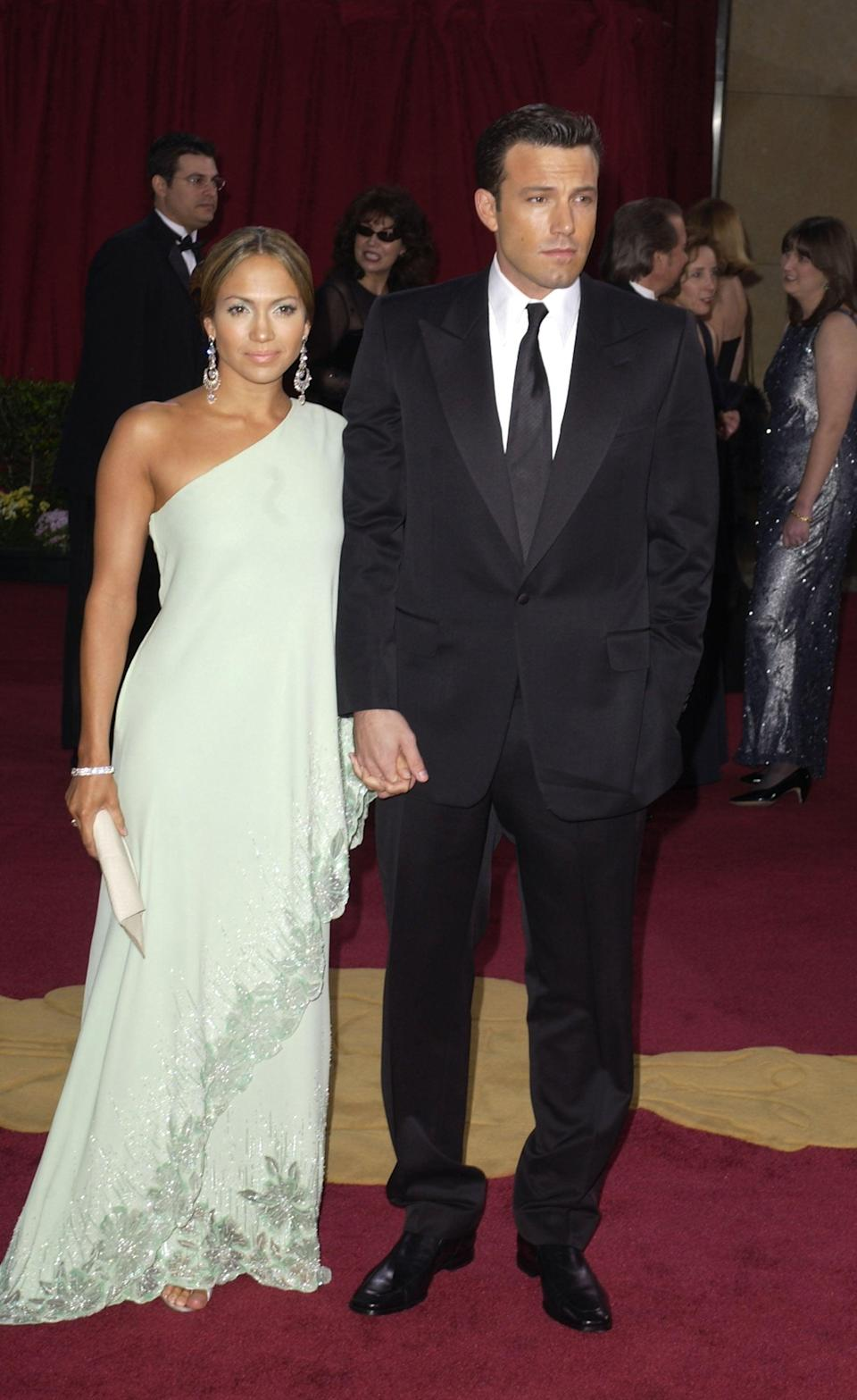 <p>For the 2003 Oscars, Jennifer slipped into a now-iconic one-shouldered Valentino gown with chandelier earrings and Ben wore a classic black tux. </p>