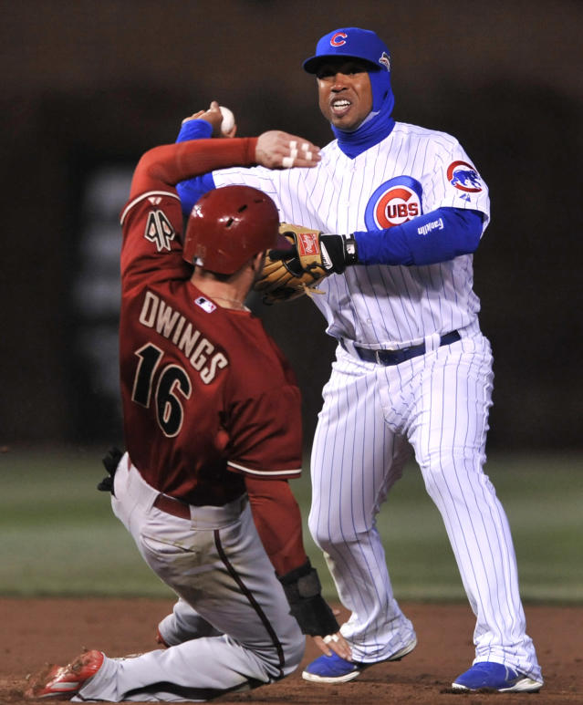 Chicago Cubs second baseman Luis Valbuena throws to first base after forcing out Arizona Diamondbacks' Chris Owings (16), at second base during the third inning of a baseball game in Chicago, Tuesday, April 22, 2014. (AP Photo/Paul Beaty)