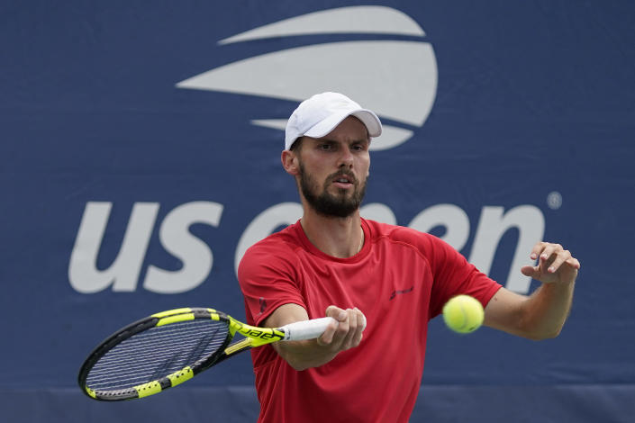 Oscar Otte, of Germany, returns a shot to Lorenzo Sonego, of Italy, during the first round of the US Open tennis championships, Tuesday, Aug. 31, 2021, in New York. (AP Photo/Seth Wenig)