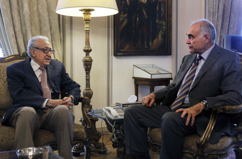 U.N.-Arab League international Syria mediator Lakhdar Brahimi, left, meets with Egyptian Foreign Minister Mohammed Kamel Amr in Cairo, Egypt, Saturday, June 15, 2013. Syrians are being killed at an average rate of 5,000 per month, the United Nation said Thursday as it raised the overall death toll in the civil war to nearly 93,000, with civilians bearing the brunt of the attacks. (AP Photo/Amr Nabil)