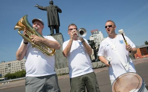 Steve Wood 54, John Hemmingham 55 and Steve Homes 47 of the England Band in Lenin Square - Credit:  Aaron Chown/ PA
