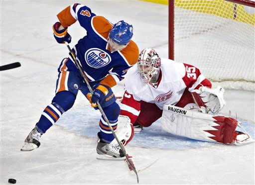 Detroit Red Wings goalie Jimmy Howard (35) makes the save on Edmonton Oilers' Taylor Hall (4) during the second period of an NHL hockey game Friday, March 15, 2013, in Edmonton, Alberta. (AP Photo/The Canadian Press, Jason Franson)