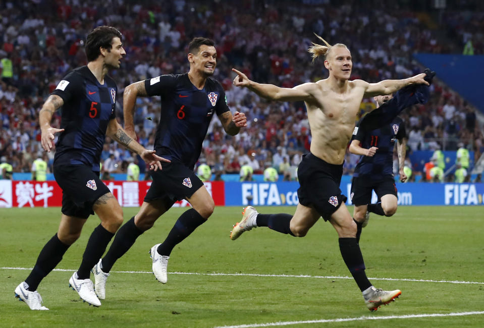 Croatia's Domagoj Vida, right, celebrates with his teammates after scoring his side's second goal during the quarterfinal match between Russia and Croatia at the 2018 World Cup. (AP)