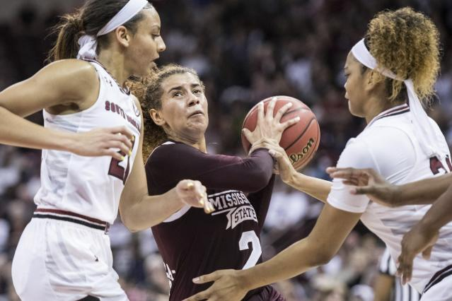Mississippi State guard Andra Espinoza-Hunter (2) drives to the hoop against South Carolina forward Alexis Jennings, right, and Mikiah Herbert Harrigan (21) during the first half of an NCAA college basketball game Sunday, March 3, 2019, in Columbia, S.C. (AP Photo/Sean Rayford)