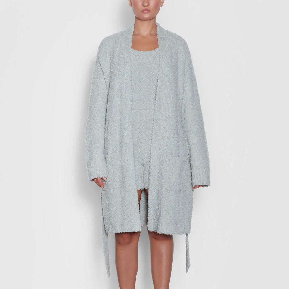 """<h2><a href=""""https://skims.com/products/cozy-knit-short-robe-aqua"""" rel=""""nofollow noopener"""" target=""""_blank"""" data-ylk=""""slk:Skims Cozy Knit Short Robe"""" class=""""link rapid-noclick-resp"""">Skims Cozy Knit Short Robe</a></h2><br>From the loungewear queen herself, we wouldn't expect her to make anything other than literally the coziest robe we could find. This one is the perfect knee-length and comes in a range of KKW's signature muted hues. <br><br><br><br><strong>Skims</strong> Cozy Knit Short Robe, $, available at <a href=""""https://go.skimresources.com/?id=30283X879131&url=https%3A%2F%2Fskims.com%2Fproducts%2Fcozy-knit-short-robe-aqua"""" rel=""""nofollow noopener"""" target=""""_blank"""" data-ylk=""""slk:Skims"""" class=""""link rapid-noclick-resp"""">Skims</a>"""