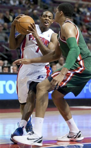 Detroit Pistons' Brandon Knight, left, drives against Milwaukee Bucks' Tobias Harris in the second half of an NBA basketball game Friday, Feb. 3, 2012, in Auburn Hills, Mich. Knight led all players with 26 points as the Pistons won 88-80. (AP Photo/Duane Burleson)